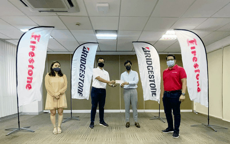 (L – R): Micaela Agoncillo, Corporate Communications Manager of HOPE Foundation; Oliver Sicam, Marketing & Strategy Director of HOPE Foundation; Marc Tagle, President & CEO of Bridgestone Philippines; and Danny Cervas, VP for Operations of Bridgestone Philippines.