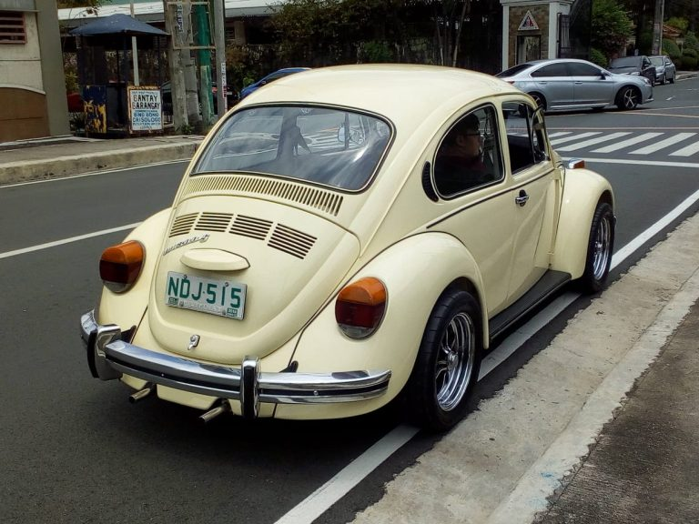 … while the big tail lights, pea shooter exhaust, and shiny EMPI wheels add more curbside appeal.
