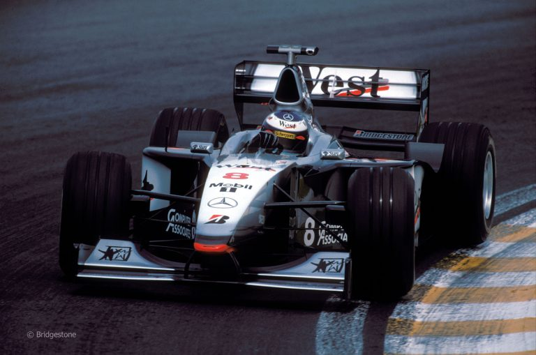 Mika Häkkinen and McLaren-Mercedes won the 1998 Formula One championship on Bridgestone tires