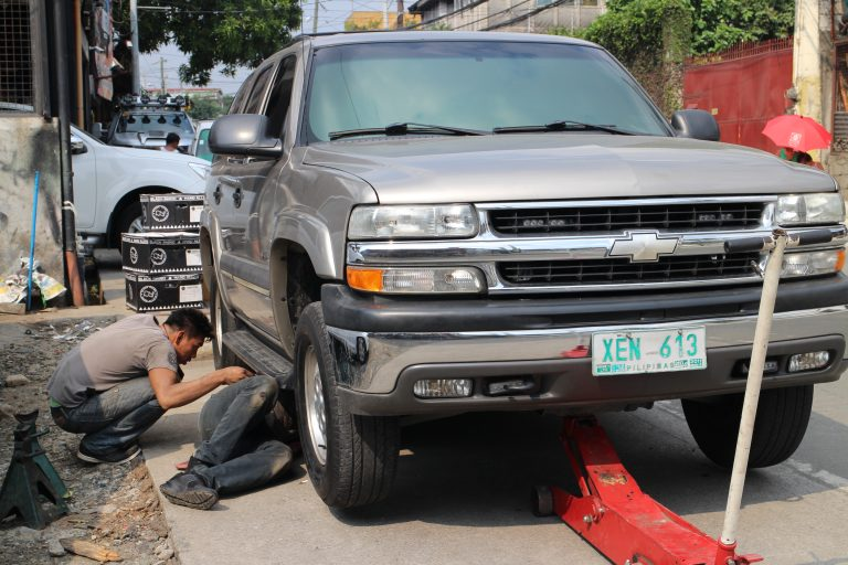 The Tahoe was driven for a short distance to load the suspension and then jacked up to adjust the front ride height.
