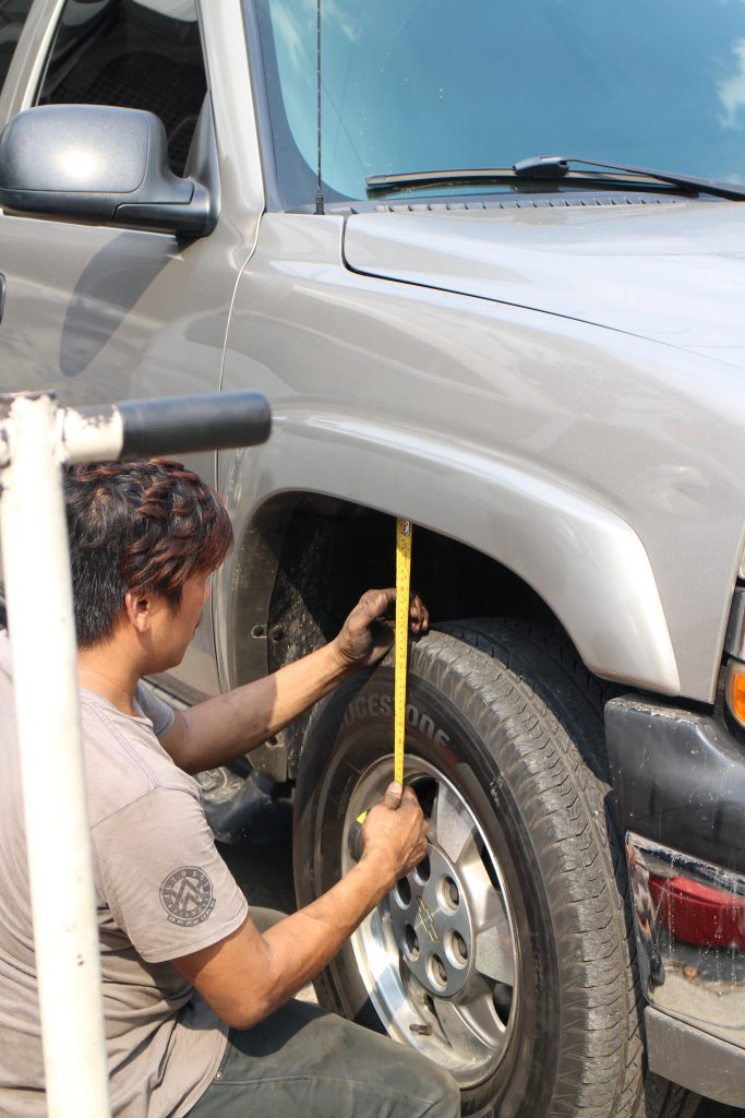 """After another short drive to load the suspension, the front wheel gaps were found to be 7"""" on the right and 6 ½"""" on the left. The mechanic adjusted the right front wheel gap to measure 6 ½"""" same as the left side for a slight rake that would straighten when the Tahoe is fully laden with passengers and cargo."""