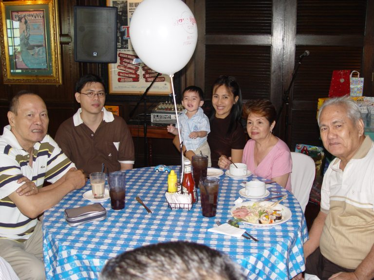 "Ildefonso ""Fons"" Caluag (left) and Atty. Jaime ""Jimmy"" Dizon (right) at the first birthday of Jimmy's grandson, Chevy Martin in 2006."