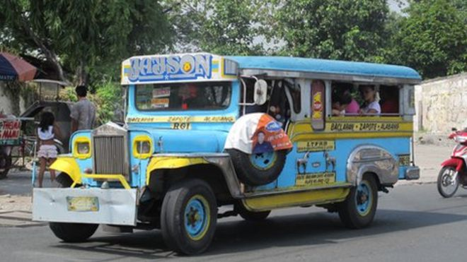 Jeepney with worn tire
